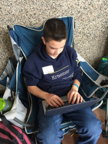 Kraemer Science Olympiad student Robbie Blank studying at the Regionals competition.