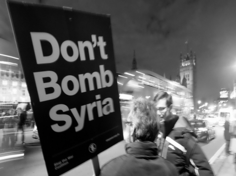 People protesting the bombing of Syria