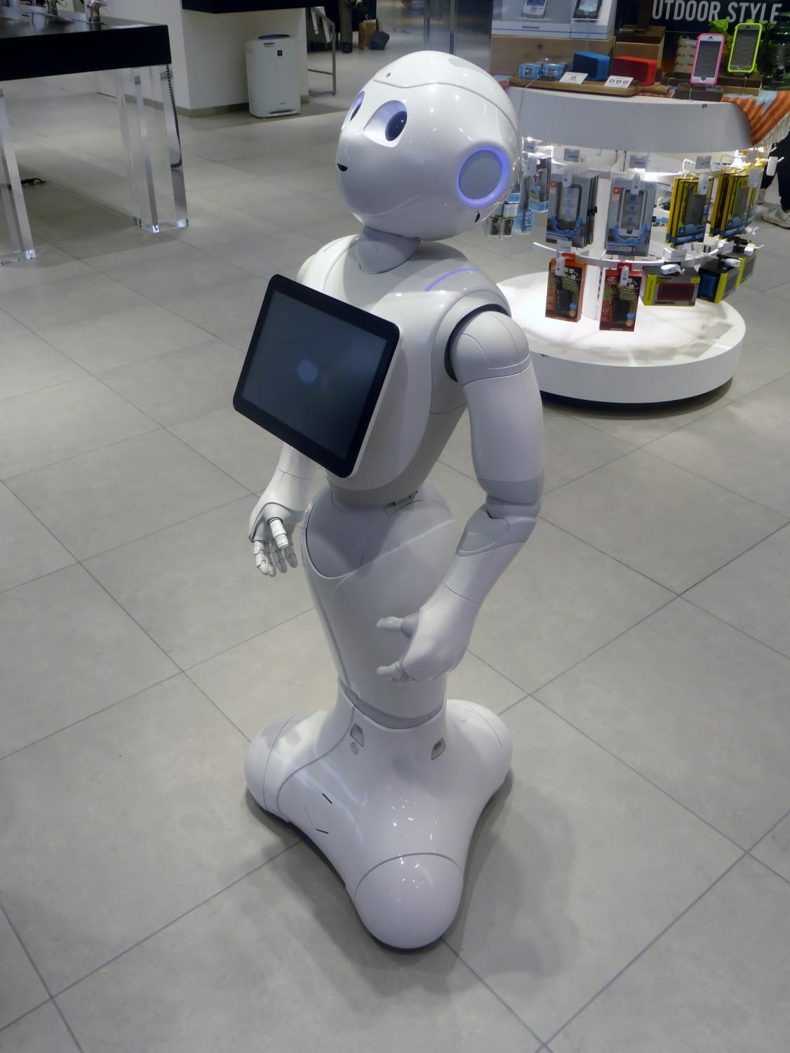 The robot Pepper standing in a retail environment.