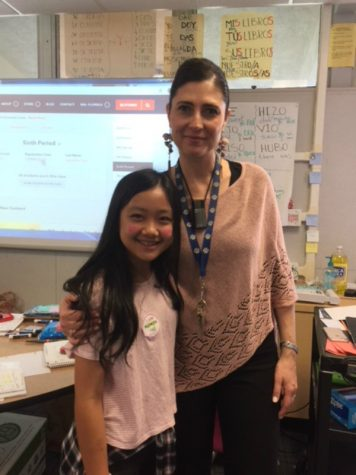 Mrs. Filipescu in her classroom with a student.