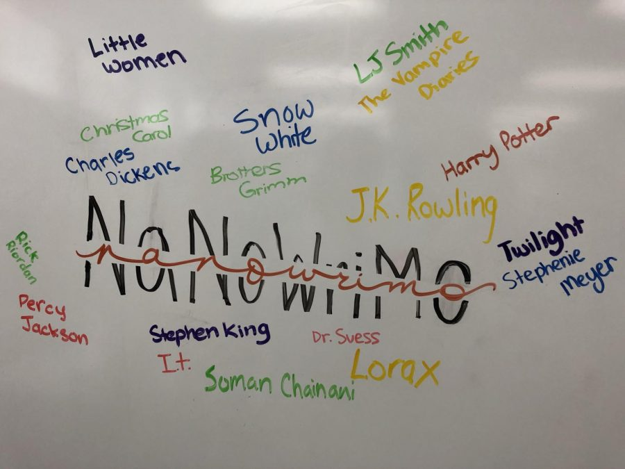 The+logo+of+NaNoWriMo+with+the+names+of+popular+authors+and+books+by+Kraemer+students+Mia+R%2C+Anya+D%2C+and+Jacqueline+C.