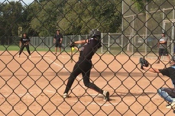 Alanna Reynoso playing softball at one of her games
