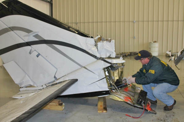 NTSB investigator examining the tale of a Cessna 414A