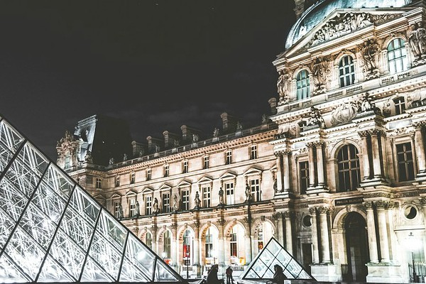 The famous Louvre Museum located in Paris, France, at night.