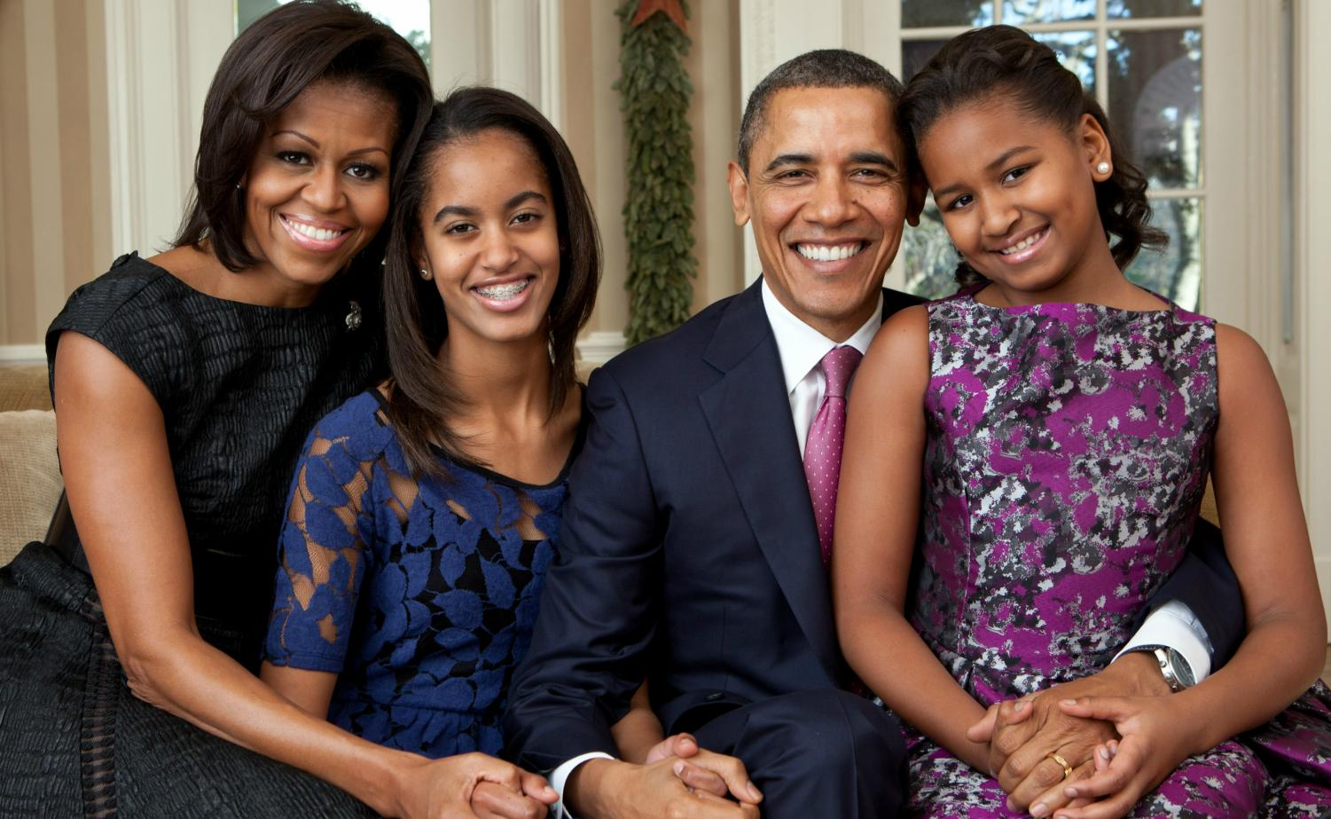The Obama family in 2011. Former POTUS Barack Obama pictured right center next to his two daughters Sasha and Malia. Former First Lady, Michelle Obama is pictured far left.