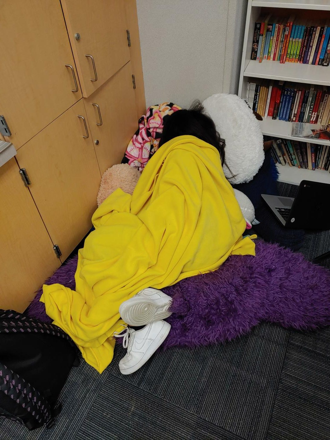 A picture of a productive student sleeping in a class.