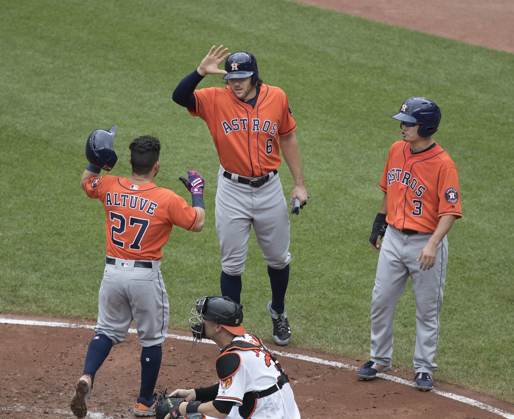 Astros at Orioles giving high fives each other showing good sportsmanship
