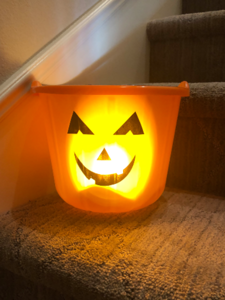 Pumpkins have been an iconic symbol of Halloween with many kids using pumpkin themed buckets to hold candy in.
