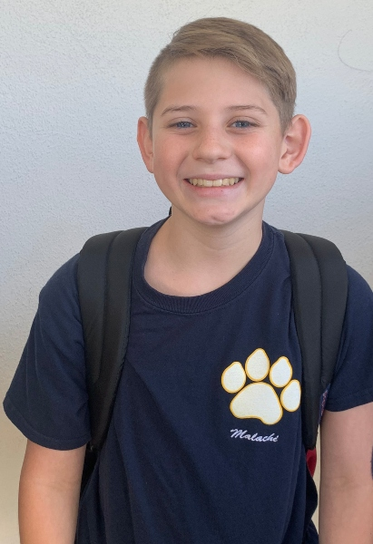 8th grader, Malachi Z. working hard and representing K2K, and making a difference for others.
