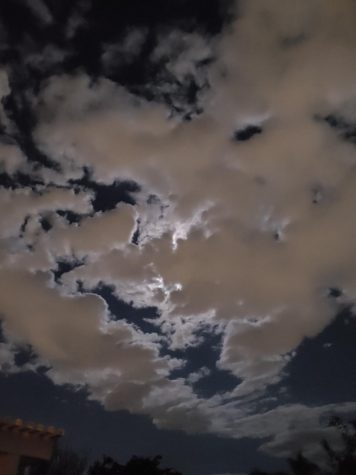 A photo of the Moon covered by clouds so it