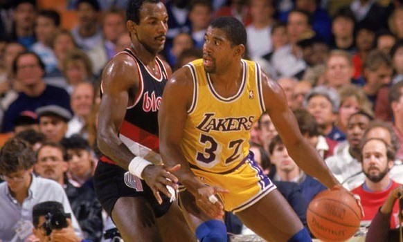 Magic Johnson posting up on one of the wizards players years ago