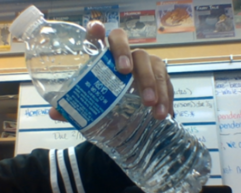 Water bottle which is half full so it shouldn